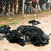 Discarded niqabs lie in a pile outside the camp where women took them off as soon as they arrived. <br /> <br /> Date: 04 March 2017<br /> Photo: NRC/Melany Markham