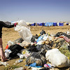 Child at improvised rubbish dump in the transit area of Domiz camp. Photo: NRC/Christian Jepsen