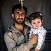 A Syrian refugee with his daughter in Domiz camp.