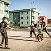 Syrian refugee children playing football in their new neighborhood in Var city in Dohuk province, northern Iraq.