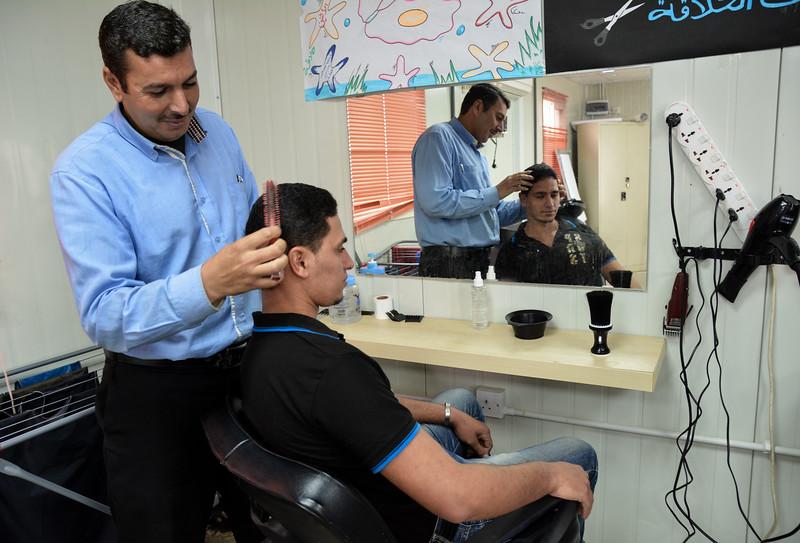 Students at NRC's youth skills centre practicing hairdressing.<br /> November 17, 2015 Photo: Dara Masri/NRC Jordan