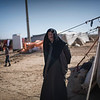 Khaled stands in front of his tent in Mafraq