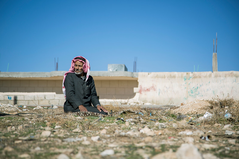 Syrian Refugee prays outside his tent.