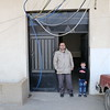 Abdul Wahab Taha, 48, and his son Hamza, 6, at the enterance of their house in Bekaa, Lebanon. Abdul Wahab is a Syrian refugee in Lebanon living in Bekaa with his wife and 5 children. Abdul Wahab studied nursing in an institute in Syria and worked as a Nurse in Syria before he fled with his family in November 2011. Now in Lebanon, it is hard to find work in his domain.<br /> Abdul Wahab is a beneficiary of NRC's ICLA programme. We visited him to know more about the difficulties he and his family are facing with obtaining residency in Lebanon Names of minors should be changed in accordance to child protection policies.<br /> Photo by: Mike Bruce/NRC