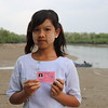Zin Hnin Phyu (14) just received her ID-card with assistance from NRC .