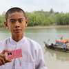 Thar Zin Paing (14) just received his ID-card with assistance from NRC .-