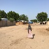 A girl walking through an UPD settlement in Maiduguri, noth eastern Nigeria.
