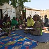 Meeting with IDPs living in host communities in Maiduguri, in north eastern Nigeria. NRC staff is discussing with the women how we can support income generation and livelihood opportunities. NRC has supported the families with temporary shelters.  Photo: NRC/Siri Elverland