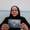"""Abeer, 40, is a Syrian national who fled from Yarmouk Camp in Damascus to the Gaza Strip with her Palestinian husband through the tunnels with the Egyptian border in December 2011. She holds a picture of her six daughters and one son from her first husband, who died of an illness in 2008. Since getting married again she has been facing a lot of problems to keep custody of her children and finally had to leave Syria without them. <br /> """"I fled the war in Syria and since then I've had another two here in Gaza,"""" Abeer said. """"The last war was very frightening. Unlike in Syria, there was nowhere safe to go to, it's too small here and all borders are closed. I don't know how we survived."""" <br /> Since she arrived in Gaza, Abeer had another son and meanwhile she has learnt that her children in Syria have been separated: some are living with their relatives, some in a centre for orphans, and her 14-year-old daughter was forced into getting married. Another daughter aged 18 was also forced into marriage when she was 15. <br /> """"I'm trapped here: I can't go back to Syria because the borders are closed. I receive little bits of news from my children and I miss them terribly; I feel I've abandoned them and it's killing me. I wish I could bring them here with me but still it would be like fleeing from death to return to death. We never know when the next war is ever going to happen."""" <br /> Photo: Karl Schembri/NRC"""