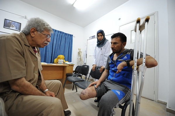 "Dr Nabeel Al Shawa (left) is a consultant orthopaedic surgeon at Gaza's only prosthetic clinic in Gaza. He is here seeing Rajaa Mohammed Hamdan from Rafah, who lost his leg and fingers when a bomb landed just outside his house while he was in the door with his 15-year-old son Mohammed. <br /> ""It all happened in a question of seconds,"" Rajaa says. ""My son died on the spot. I was on the phone when the bomb fell, so my hand was protecting my head and that's how I lost my fingers but managed to stay alive."" <br /> Rajaa spent months in Egypt where doctors tried to save his leg but his condition degenerated and they had to amputate it last February. <br /> ""Life has changed completely for me,"" Rajaa said. ""I don't go out anymore. I don't want anyone to see me like this. I couldn't move for some six months, and now that I can move a bit I'm just ashamed."" <br /> Dr Nabeel said: ""Over the years, in different wars, I've seen all sorts of wounds and operated in some of the most chaotic situations, but when the physical pain and shock subsides, the psychological effects of amputations are just devastating."" <br /> Photo: Karl Schembri/NRC"
