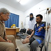 """Dr Nabeel Al Shawa (left) is a consultant orthopaedic surgeon at Gaza's only prosthetic clinic in Gaza. He is here seeing Rajaa Mohammed Hamdan from Rafah, who lost his leg and fingers when a bomb landed just outside his house while he was in the door with his 15-year-old son Mohammed. <br /> """"It all happened in a question of seconds,"""" Rajaa says. """"My son died on the spot. I was on the phone when the bomb fell, so my hand was protecting my head and that's how I lost my fingers but managed to stay alive."""" <br /> Rajaa spent months in Egypt where doctors tried to save his leg but his condition degenerated and they had to amputate it last February. <br /> """"Life has changed completely for me,"""" Rajaa said. """"I don't go out anymore. I don't want anyone to see me like this. I couldn't move for some six months, and now that I can move a bit I'm just ashamed."""" <br /> Dr Nabeel said: """"Over the years, in different wars, I've seen all sorts of wounds and operated in some of the most chaotic situations, but when the physical pain and shock subsides, the psychological effects of amputations are just devastating."""" <br /> Photo: Karl Schembri/NRC"""