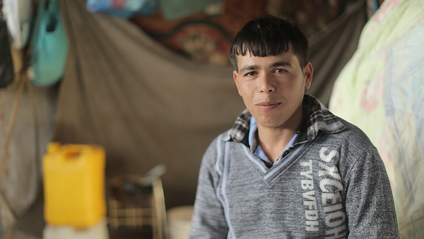 Thaer Al Sheesh, 30, father of three girls and a four-months-old boy, from Beit Lahiya, had his house destroyed in the last war almost three years ago. He is still living in a tent with his 53-year-old mother, Intisar, and his family, as they wait for their house to be rebuilt. His baby was recently attacked by a dog which entered their tent at night<br /> <br /> Life is difficult and there is no work. There is the blockade, too. I used to work in a sewing factory. I used to earn 30-40 shekels per day. Since the blockade was imposed, work stopped and the sewing work came to halt. This has affected all youth, not just me. After that, the war started and we got displaced when our house was bombed. We took refuge in shelter schools that were open for the displaced. We stayed there during the war, which was very hard on us. Children were dying, my daughters were terrified; we were all terrified. It wasn't just us, but the whole Gaza Strip was terrified. <br /> <br /> When the war ended, we returned home and we found that it was completely destroyed. We stayed again in schools for a while, then we rented a house for a month or two. I had no money to pay the rent, nor work. The landlord used to come to me asking for rent and I couldn't pay him. So Ibuilt a tent and stayed in it for three years, while waiting for Gaza to be rebuilt. We're still living in it.<br /> <br /> The crossings were closed, there was no money flowing into Gaza. It was difficult for everyone to survive. I wanted to work but where could I find a job? We used to get our basics from the mini market without paying for months, then when I receive some money after three months, it would be entirely used to pay my dues to the shop. I need milk for my children, diapers, food, beverages, cooking gas... I'd like to have a fridge and an oven, and many other things for my children, but I can't get them. <br /> <br /> We are alive now because death hasn't bothered to take us yet. It will be way better for us to d