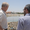 """Jan overlooks the water reservoir with NRC's WASH/Shelter Coordinator, Ahmed, who provides technical guidance and support in the project carried out alongside the CMWU. Ahmed warns, """"If we do not move quickly to repair and maintain Gaza's existing, yet rapidly deteriorating water network and sanitation infrastructure, we could face grave public health risks. Hundreds of cubic meters of untreated sewage are pumped into the sea daily, and we don't want more to end up in Gaza's streets.""""<br /> <br /> Photo: Ahmad Mashharawi/NRC<br /> 5 June, 2017"""
