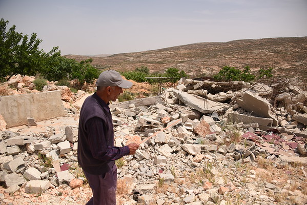 Background: A small community of farmers living in Jourat Al Khiel, which falls in Area C, already once displaced from their land nearby, has been facing continuous settler violence and the threat of destruction of their homes. Their worst fears came to reality last August when Israeli soldiers turned up with bulldozers early in the morning and destroyed their homes, water wells and sheds for their livestock. NRC is assisting the community with legal aid, representing them in Israeli courts, in a bid to stop further property destruction and displacement of this vulnerable community.<br /> <br /> Ahmed Mohamed Mustafa Al Shalaldeh<br /> We grew up on the land over there called Al Sarara. In 1983 they (the Israelis) started building on it. They said it's a military camp and it will not include any settlers. Then they kicked us out and we came here. <br /> <br /> At first we set up tents. We couldn't build as we were afraid to do so. We lived in tents for 15 years. Then we built some rooms.  We built houses that included two bedrooms, a bathroom and a kitchen. We need to live. We don't have electricity or water. <br /> <br /> In 2014 they distributed leaflets, then they served us eviction notices. They asked us to apply for permits, which we did through our lawyer. In August 2016, at 5.30am, they came with bulldozers. We asked them what was going on, they told us to get out of the house. We told them we had applied for permits and had the documents needed, but they said they were not aware of our documents and that they had orders to take down our buildings. We told them we needed to get our clothes, but they said they'd get them for us. They brought us some clothes and demolished our houses with all the other belongings inside. They demolished seven houses.<br /> People were displaced for four months. They had no tents or shelter. Some moved to the village and others set up some kind of shelter. Then we were given these caravans by aid groups.<br /> <br /> We'd love t
