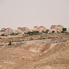 "The settlement of Maale Adumim surrounds the community of Wadi Al Jimel, where a community of Palestinian Bedouin refugees from Beer Sheva is facing the threat of forced eviction, home demolitions and continuous settler violence from the nearby settlement. <br /> The community is located in Area C, under full Israeli security and administrative control. The community is at risk of forcible transfer due to a ""relocation"" plan located in the area advanced by the Israeli authorities. The community exists in a high security area, movement restrictions are imposed to people when transporting on bypass road, and when herders graze their animals in access restricted areas near the settlement and the wall. In 2002, the community was separated from Jerusalem area by the separation wall.<br /> <br /> Photo: Karl Schembri/NRC"