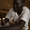 """Tibatha James, 15, takes notes in class at the Hope Primary School in the Protection of Civilian site for displaced people in Juba, South Sudan, August 10, 2016. ©NRC/Adriane Ohanesian<br /> <br /> """"My favorite subject is English because it's an international language. I want to be a doctor when I grow up."""" - Tibatha James, 15"""