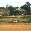 Image of the damage after renewed fighting in Juba in July 2016. Several thousands were displaced and a cross can be detected in the distant background, a sign of a burial place.<br /> Photo: NRC/Carina Hansen.