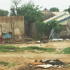 Image of the damage after renewed fighting in Juba in July 2016. Several thousands were displaced and a cross can be detected in the background, a sign of a burial place.<br /> Photo: NRC/Carina Hansen.