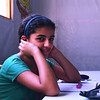 Ghada, 12, from Homs, fled to Damascus three years ago with her parents and older siblings.  She attends the Centre for children in Sahnaia on the outskirts of Damascus.<br /> <br /> Ghada said: ''I really love the centre and coming to it.  I look forward to coming here every day.'<br /> <br /> ''I am lucky.  I still have my family.  However I miss my house in Homs, my schools and my friends.''<br /> <br /> Supported by NRC, the centre is run by a community-based association which assists around 150 displaced children from across Syria and others from the community catch up on their education. The centre runs catch-up classes for children and hosts recreational and life skills activities through its Summer Programme for children who have been out of school because of the crisis and displacement. Children are prepared to pass government-recognised exams in Arabic, Maths and English so they can eventually return to formal schools  NRC also helps to facilitate a vital link between this community-based initiative and the Ministry of Education.  <br /> <br /> NRC has been supporting the centre since June 2016, providing student backpacks and supplies, teaching materials, teacher training, and providing administrative support to the association.<br /> <br /> Photo: Karl Schembri/NRC<br /> 24 August 2016