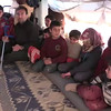 Video: Internally displaced Syrian man and children in a tent at Alharameen informal camp.