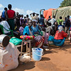 NRC has the right to use and publish these photos for TWO years, until August 2018. Photographer Sofi Lundin to be credited every time they are published.<br /> <br /> Adjumani, north Uganda, August 2016. <br /> <br /> These South Sudanese refugees have just arrived Uganda. Sitting waiting outside the Nyumanzi reception centre, they are waiting to be transported to a settlement.<br /> ---<br /> <br /> NRC assists refugees having crossed into north Uganda after the renewed fighting in South Sudan. Between 7 July and 25 August, close to 95,000 South Sudanese refugees crossed into north Uganda<br /> <br /> Photo: Sofi Lundin