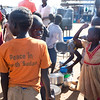 NRC has the right to use and publish these photos for TWO years, until August 2018. Photographer Sofi Lundin to be credited every time they are published.<br /> <br /> Adjumani, north Uganda, August 2016. <br /> <br /> Women and children stand under the blazing afternoon sun, waiting to receive their food rations. In August 2016, because of lacking resources, the food rations were reduced by half for the refugees who had arrived after 15 July 2016. <br /> ---<br /> <br /> NRC assists refugees having crossed into north Uganda after the renewed fighting in South Sudan. Between 7 July and 25 August, close to 95,000 South Sudanese refugees crossed into north Uganda<br /> <br /> Photo: Sofi Lundin