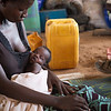 """NRC has the right to use and publish these photos for TWO years, until August 2018. Photographer Sofi Lundin to be credited every time they are published.<br /> <br /> Adjumani, north Uganda, August 2016. <br /> <br /> Alice Drama (24) is sitting on the tent floor with her two-week-old baby. Her son is one of many children born a refugee. The new-born is breathing heavily. It is blazing hot inside the tent. Drama was heavily pregnant when she escaped and crossed the border, after her husband left her for another wife. Now she dreams of a peaceful life and a secure future for her son.<br /> <br /> """"I'm so tired of the war. I cannot stand to be afraid anymore. Now, I think about my boy's future. I hope he will be fine,"""" says Drama.<br /> <br /> While the number of refugees in South Sudan's neighbouring country Uganda is increasing, the war continues to ravage the world's youngest country.<br /> ---<br /> <br /> NRC assists refugees having crossed into north Uganda after the renewed fighting in South Sudan. Between 7 July and 25 August, close to 95,000 South Sudanese refugees crossed into north Uganda<br /> <br /> Photo: Sofi Lundin"""