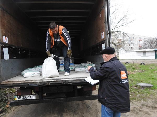 Civil Engineer Oleksandr Prokopov checking construction materials  delivered to Shchastia town