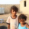 """Amina 7 years old and her sister Aisha who is only 4 years old had to flee their home 2 years ago owing to airstrikes with their 35 years old widow mother. They are now living  in an abandoned house in Al-Zuhra District in Al-Hudaydah Governorate. """"We came here with empty hands, we did not have clothes or mattresses, we had nothing. When we first came the neighbours gave us some basics to live on."""" Their mother A'aish  said to NRC. A'aish is one of NRC beneficiaries she received unconditional cash """"My only wish is to ensure my children will live with dignity. I used most of the money I received to buy food and the rest I spend on providing my children with clothes and mattresses"""" A'aish added.  Photo: Nuha Mohammed/NRC"""