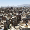 "I recently posted an up-to-date photo of the beautiful old city Sana'a of on my facebook wall. It is an enchanting place and people have lived here for thousands of years. History breaths in the ancient walls, narrow streets, and the characteristic white paint around colorful glass windows.  <br /> <br /> ""In my mind this was all ruins, thanks for sharing,"" a friend commented under the photo. She thought the old city had become rubble. <br /> <br /> Images of war: Death, ruins and rubble, in places where beauty struggle to survive. War is destruction - of lives, of livelihoods and of homes. But the destruction of war has many shades and layers. Coming back to this city that I know from strolling around in its streets during times of peace, the shades and layers of war in Yemen become increasingly and painfully evident.<br /> <br /> There are ruins, and there is rubble. Even in the heritage site and very much alive old city, there are ruins. A wall disclosing open rooms and shattered mudbricks is what is left of a line of five houses that used to be homes. At another spot within the densely populated neighborhood, 11 family members died when a strike hit their house on the 19 of September last year. Factories and wedding halls across the capital and country have have been demolished. <br /> <br /> Photo: NRC/Alvhild Stromme"