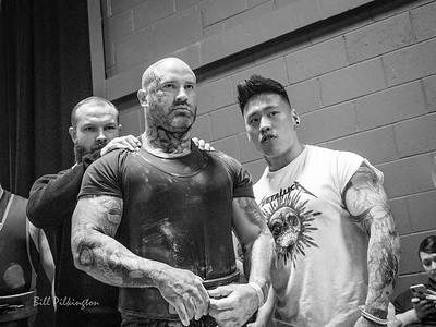 Tattooed and strong weight lifter