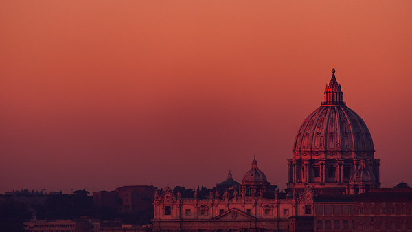 The Papal Basilica of St. Peter in the Vatican during sunrise.