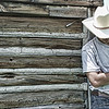 """Feb 18 - Break Time - This shot was taken in Wyoming of my son in the hot sun.  I muted the colors a little bit to give it a """"rough"""" cowboy atmosphere."""