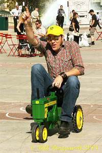 Brad Stella crosses the finish line victorious at the Great John Deere Tractor Race