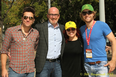 Don Green, CEO of the Canadian Country Music Association with The Stellas and Adam Gregory at the Great John Deere Tractor Race.