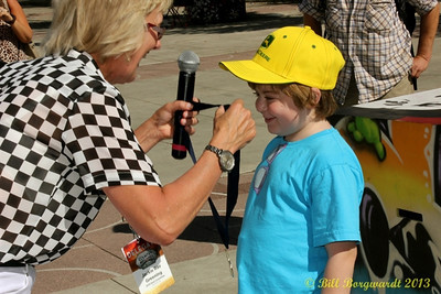 A proud member of Team Stella receives his gold medal at the Great John Deere Tractor Race