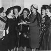 The Nashville Herald, February 17, 1949<br /> MEMBERS OF THE AMERICAN LEGION AUXILIARY of the Eighth District held a meeting in Nashville Sunday.  Shown discussing an Auxiliary matter, left to right are:  Mrs. John Williams, Valdosta, past department president of the Auxiliary; Mrs. E.J. Ennis, Brunswick, second vice-president department of Georgia; Mrs. Fred T. Allen, president of Eighth District; Mrs. Herbert Moon, Americus, department chairman of national security; Mrs. P.M. Wise, Winder, state Auxiliary president; Mrs. D.B. Harrell, Brunswick, department chairman of Girls' State; Miss Ruth Reid Hill, Rochelle, Third District Auxiliary president.