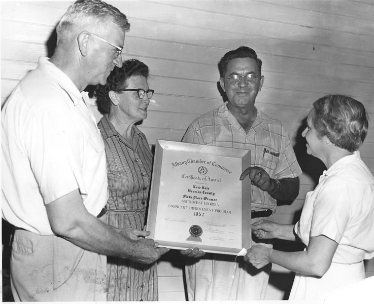 New Lois Improvement Committee receives the Southwest Georgia  Community Development Award, 1957. Shown left to right: Bernys W. Peters, Nan Rix, Leah R. Stallings, and Frances Stallings.