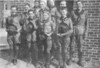 Nashville Scout Troop in front of City Hall on the corner of Washington and Bartow Streets, about 1937, taken from a newspaper proof. <br /> Front row, left to right: Newt Sirmans, Clarence Boone, Broshie Sirmans, Ernest Smith.<br /> Back row, left to right: June Sirmans, Charlie Sirmans, Randall Parrish, Barney Hodges, Weston Meyers. Original photo and  corrections needed.