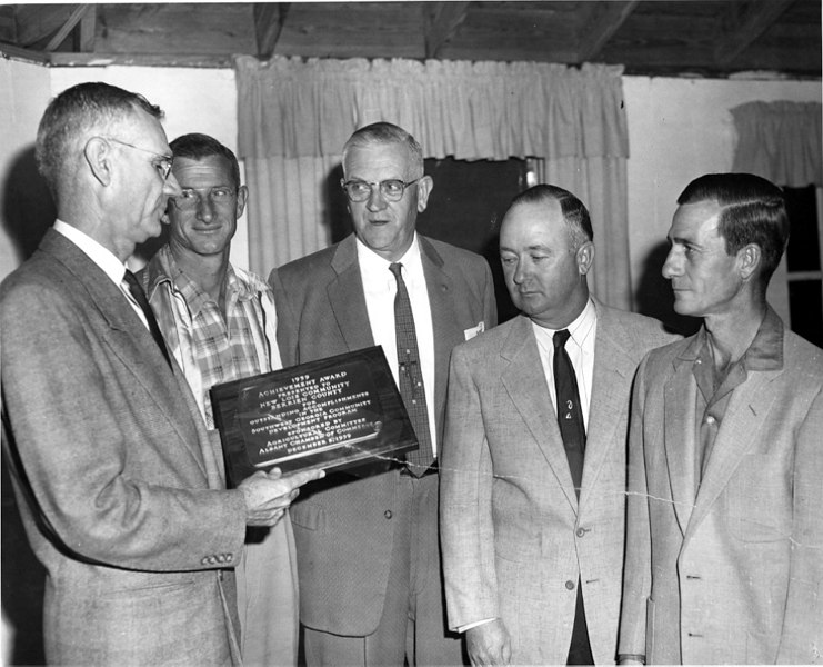 New Lois Community Improvement Committee receives the Southwest Georgia Development Award 1959. Shown left to right: ––––––– Smith, Sam Watson, Bernys W. Peters, Terrell Swindle, Raymond Tyson.