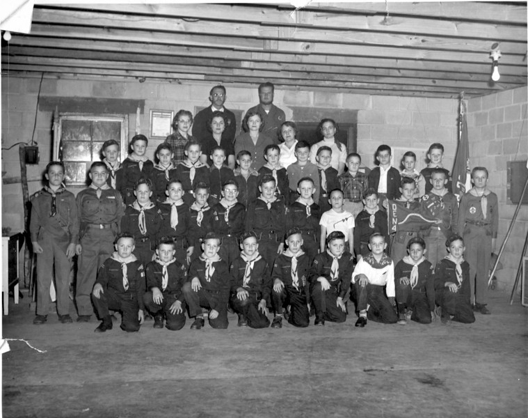 """Nashville Boy Scouts, Scoutmasters Yates Hancock and Robert """"Bob"""" Drake, January 26, 1956. (Photo by Wink Rogers; photo courtesy of Bobby Polk).<br /> <br /> The Nashville Herald, front page, February 2, 1956<br /> photo caption:<br /> CUB SCOUTS:  Front Row left to right, Billy Outlaw, Johnny Drake, Ed Perry, Butch Brown, Michael Wisdom, Larry Bostick, S.G. Solomon, Wilson Nix, Chip Young; Second  Row, Butch Alexander, Eddie Frost (Den Chiefs), Jimmy Peters, Doug Henderson, Harold McNabb, Oren Hall, Dane Perkins, Wynn Hancock, Patrick Wisdom, Neil Levin, Mike McNeal, Roger Connell, Chris Connell (Den Chiefs); Third Row,Jjimmy Gordon, Jerry Mercer, Arch Clark, Wendell Rogers, Ronald Tomberlin, Danny Lewis, Jeff Byrd, Stanley Vickrey, Johnny McMillan, Rickey Parker, Dickie Willard, Bobby Polk; Fourth Row, Den Mothers, Mrs. Robert Drake, Mrs. Lacy Clark, Mrs. W.L. Bostick, Mrs. B.W. Wisdom, Mrs. Faye Nix, Lacy Polk, cub master, Robert Drake, assistant cubmaster.  Mr. Polk stated that a supper will be held on the third Thursday night in February at which time they will be glad to receive new members, if prospective members fail to contact Mr. Polk in time for the dinner they can apply at any regular meeting of the cub scouts on the fourt Thursday night of each month. -- Photo by Wink Rogers."""