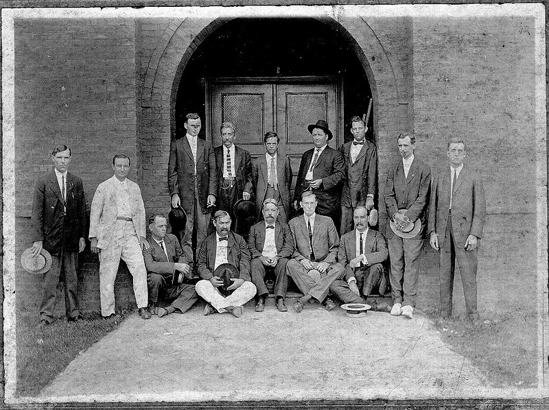 Group of men (some are attorneys), in front of Courthouse, circa 1912-15:<br /> L-R: R.J.D. Lovett, L. A. Alexander, W. G. Harrison, J. T. (Shorty) House, W. D. Buie; standing, C. A. Christian, R. A. Hendricks, Willis Avera, J. H. hull, Joe Zealy Jackson, I. C. Avera (sheriff), J. H. Gary, and E. S. Chastain