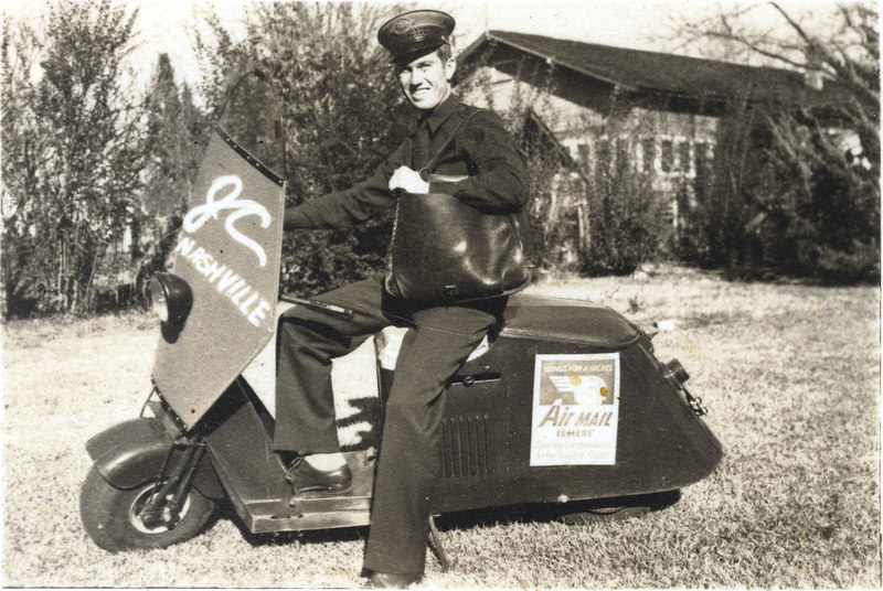Jamie Connell on his postal scooter, about 1943