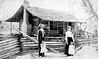 Unknown family (possibly King) and log home