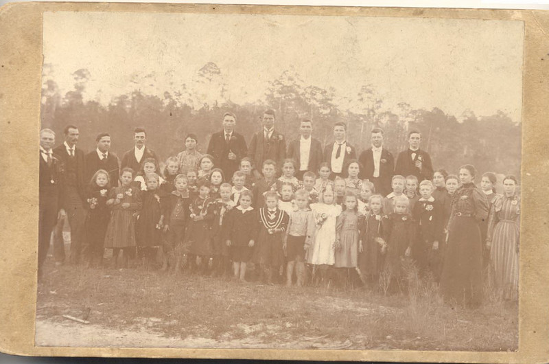 Maybe group of school children or family gathering; was probably taken in late 1890's.  I believe that my Grandfather (Adlai Bee Griner (1892 - 1973)) is in this picture because his name only is on the back of it. Also, probably his friend Jamie Tygart and Bulloch Gaskins are probably there. I know that they were his age and he spoke of them as being his school friends.  I do not know which school he attanded but he always said that they lived 1 mile north of town. Maybe<br /> someone can help us identify these folks.<br /> (Information by: Diane Pate; submit information to berriencountyga@alltel.net)