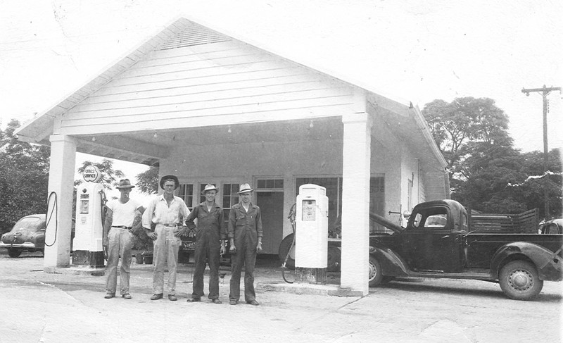 """Roland Cities Service Station, located on southeast corner of current Bank of Alapaha property, intersection of W. Marion Avenue and South Bartow Street, circa 1947. L-R: Julian Roland, Fred Hesters, William """"Billy"""" Jones, and Luther Roland. Later operated by Marvin & Faye Nix"""