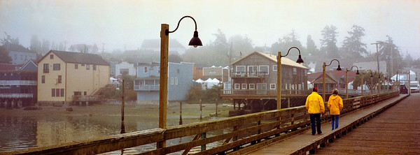 Slickers: this panorama of a boating couple walking on the Coupeville, Washington wharf took first place in the juried art show at the 2001 Historic Coupeville Arts & Crafts Festival.