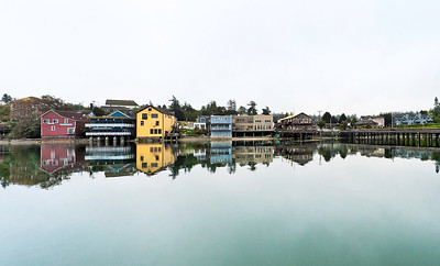 Waterfront Reflection: Coupeville, Washington, reflected in Penn Cove.