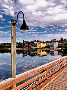 Wharf Lamp: Coupeville, Washington framed by a lamp on the historic Coupeville Wharf.