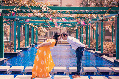 A gorgeous couple before their wedding at a swimming pool getting their prewedding photoshoot.